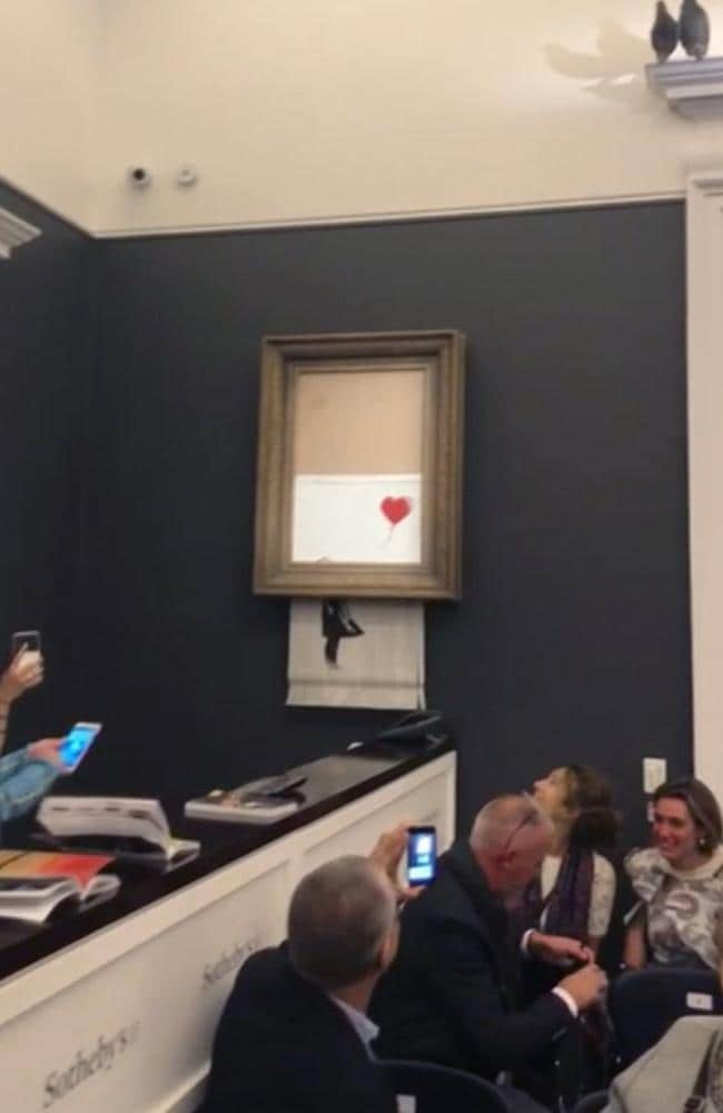The artwork selfdestructed moments after being sold at auction for ₤1.04 million ($A1.96 million), in a prank apparently orchestrated by the elusive street artist. Picture: Pierre Koukjian via AP