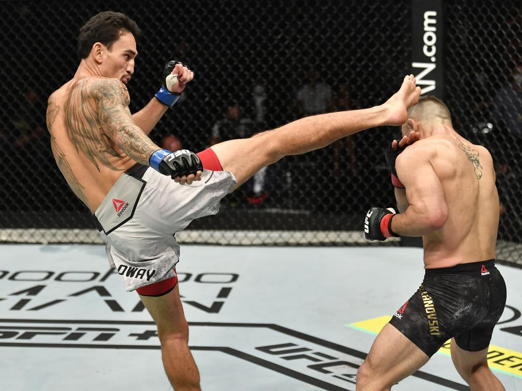 Max Holloway kicks Alexander Volkanovski. (Photo by Jeff Bottari/Zuffa LLC)