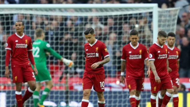 Philippe Coutinho of Liverpool and his team mates are dejected after Tottenham Hotspur's fourth goal at Wembley last season
