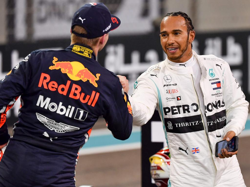 Max Verstappen shakes hands with Lewis Hamilton. (Photo by ANDREJ ISAKOVIC / AFP)