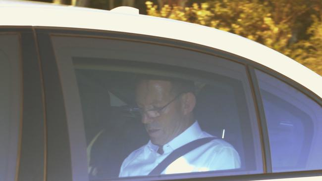 Under fire ... a troubled looking Prime Minister Tony Abbott arrives at Parliament House in Canberra. Picture: Gary Ramage