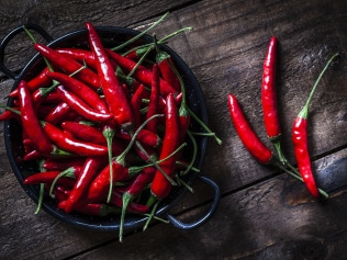 Ease up on the chillies if you're having hot flushes. Source: iStock