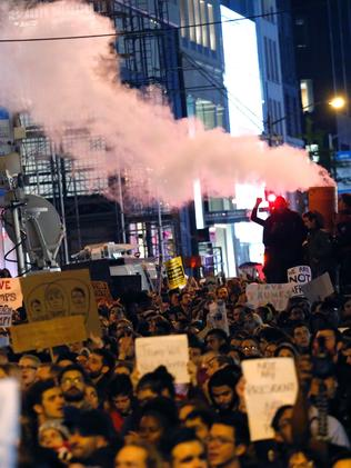 New York where thousands marched into the night. Picture: AFP PHOTO / KENA BETANCUR