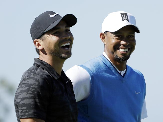 Jason Day and his friend Tiger Woods, right, reacts on the fifth hole during the first round of the Farmers Insurance Open golf tournament, at Torrey Pines Golf Course in San Diego. Day won twice this year on the PGA Tour and finished at No. 14, one spot lower than where he started. Picture: AP Photo