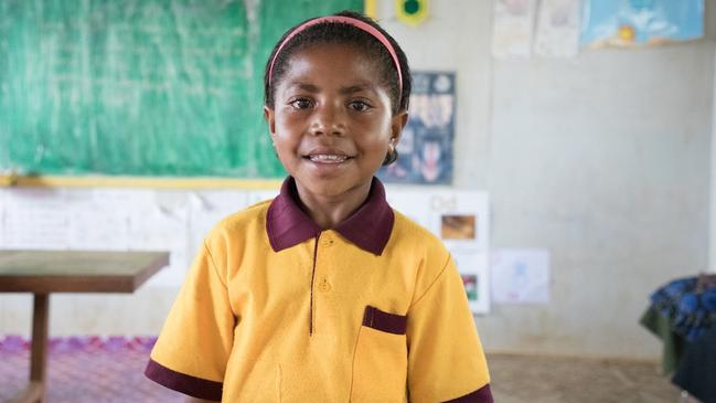 Help children like Pamela, 8, who has to walk an hour to get to school in Papua New Guinea. CARE Australia believes the best way to life families out of poverty is through education. Picture: CARE Australia.