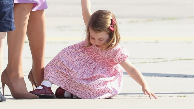 Princess Charlotte gracefully throwing herself to the ground. Photo: Getty