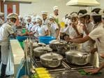 Children take part in a cookery lesson at Songdowon International School Children's Camp on August 22, 2018 in Wonsan, North Korea. Picture: Carl Court/Getty Images