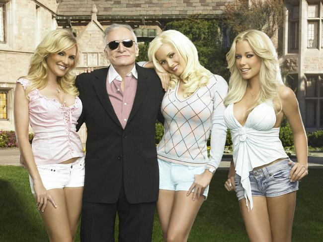 Playboy magazine founder Hugh Hefner with Playboy models, Holly Madison in a scene from TV program Girls of a Playboy Mansion.