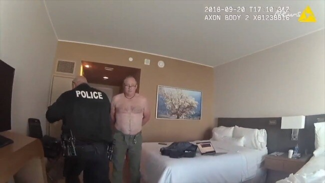 Man arrested for being naked in hotel room window