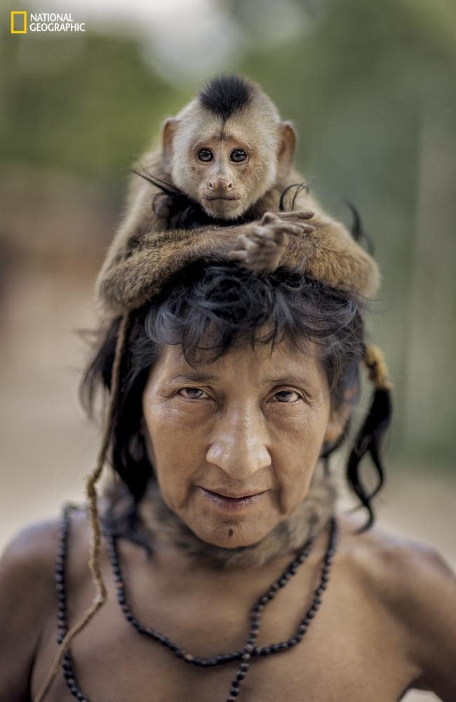The photos give the outside world a rare insight into tribal life. Charlie Hamilton James/National Geographic