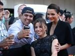 A fan gets a selfie with Brooke Satchwell and Jessica Tovey on the red carpet for the 4th Annual AACTA Awards held at The Star in Pyrmont. Picture: Richard Dobson