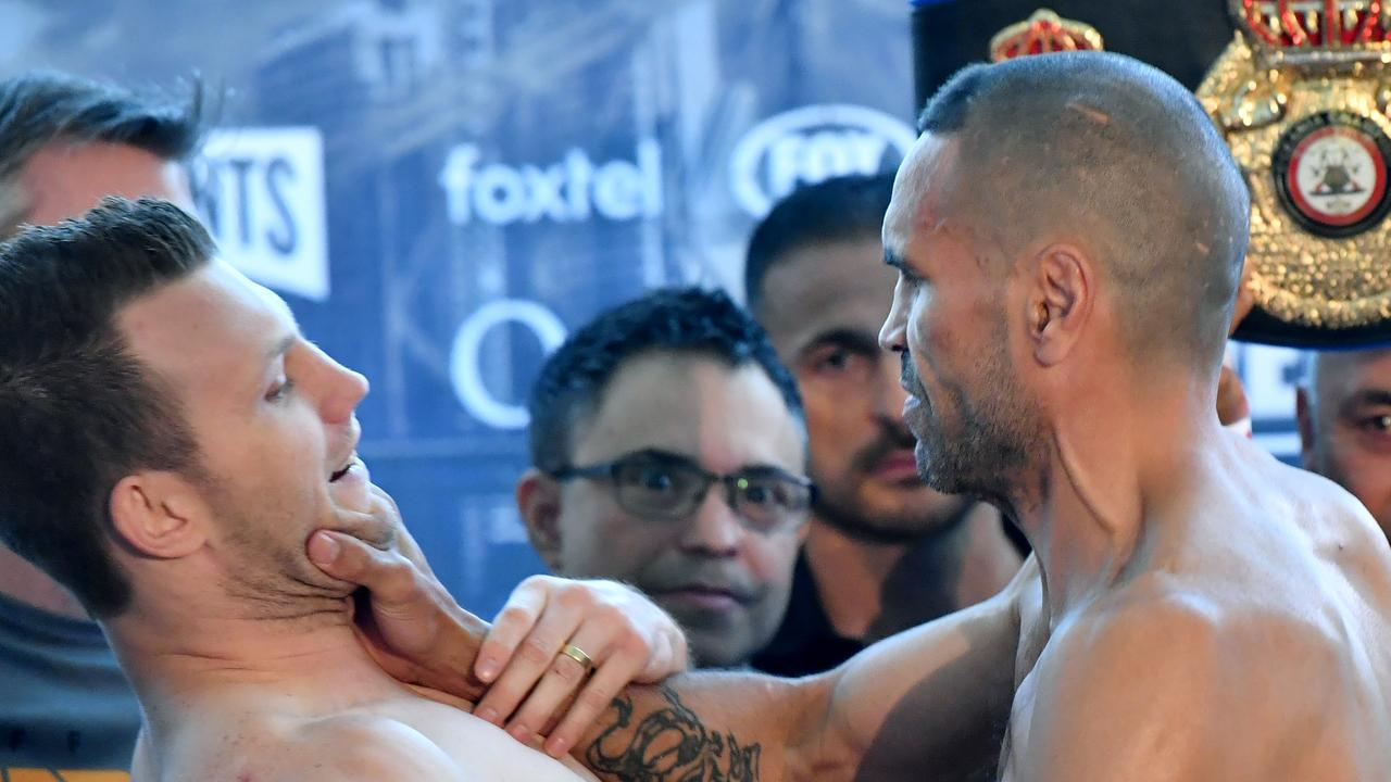 Anthony Mundine grabs Jeff Horn by the throat at the weigh-in.