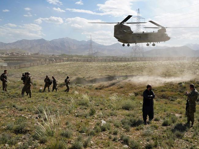 A US military Chinook helicopter lands on a field outside the governor's palace during a visit by the commander of US and NATO forces in Afghanistan, General Scott Miller, and Asadullah Khalid, acting minister of defence of Afghanistan, in Maidan Shar, capital of Wardak province. Picture: AFP