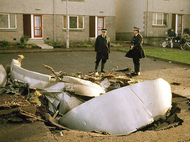 Police by the wreckage of the Pan Am Boeing 747 crashed into Lockerbie after a bomb on board exploded.