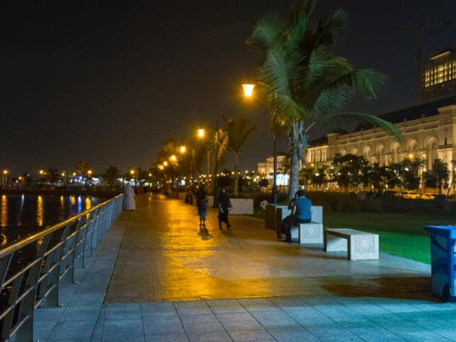 View of night-life with people hanging out and walking along the Jeddah's Corniche, a coastal resort area of the city of Jeddah in Saudi Arabia.
