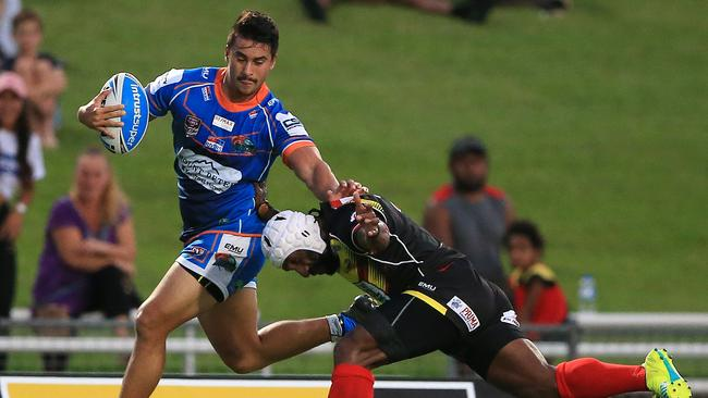 DON'T ARGUE: Northern Pride's Enari Tuala fends off PNG Hunters' Adex Wera at Barlow Park. Picture: JUSTIN BRIERTY