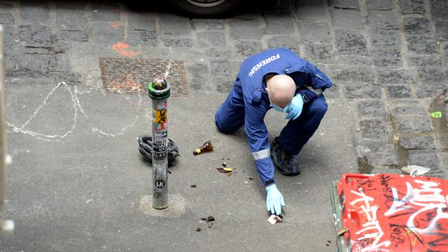 Police at the scene on Hosier Lane where they arrested Jonathon Dick. Picture: Andrew Henshaw