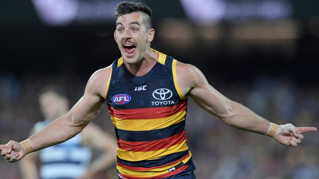Taylor Walker of the Crows celebrates a goal during the Adelaide Crows and Geelong Cats Men's AFL First Preliminary Final at the Adelaide Oval in Adelaide, Friday, September 22, 2017. (AAP Image/Tracey Nearmy) NO ARCHIVING, EDITORIAL USE ONLY