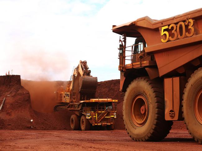 An excavator loads ore into an autonomous dump truck at Fortescue Metals Group Ltd.'s Solomon Hub mining operations in the Pilbara region. Picture: Brendon Thorne/Bloomberg