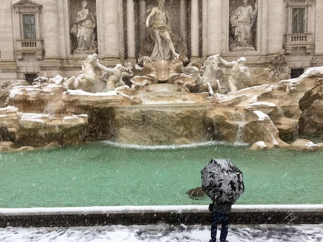 Italy's famous Trevi Fountain was also iced over. Picture: AFP