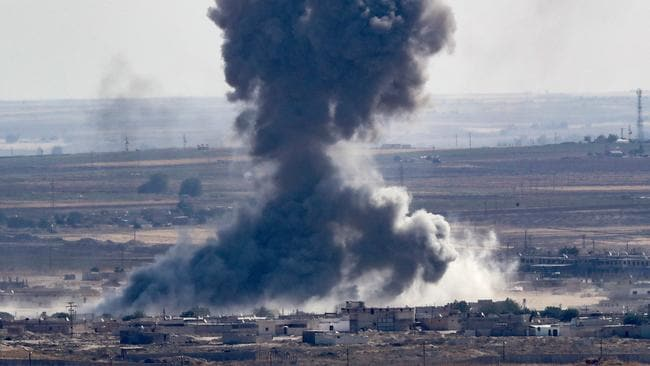 Smoke rises over the Syrian town of Ras al-Ain. Picture: Burak Kara/Getty Images
