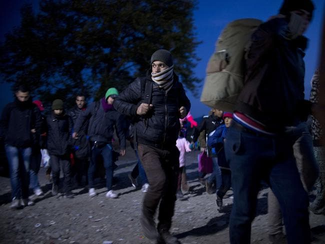 Fleeing ... migrants and asylum seekers enter a registration camp near Gevgelija, in the Republic of Macedonia. Picture: AFP/Nikolay Doychinov