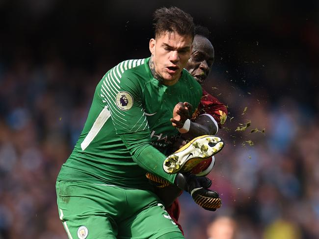 Ederson after being kicked by Sadio Mane.