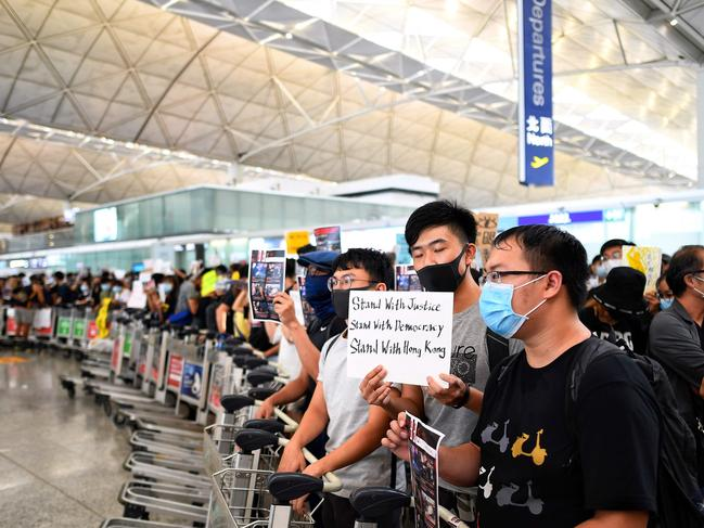 Hong Kong pro-democracy protesters block the departure gate. Picture: Manan Vatsyayana/AFP
