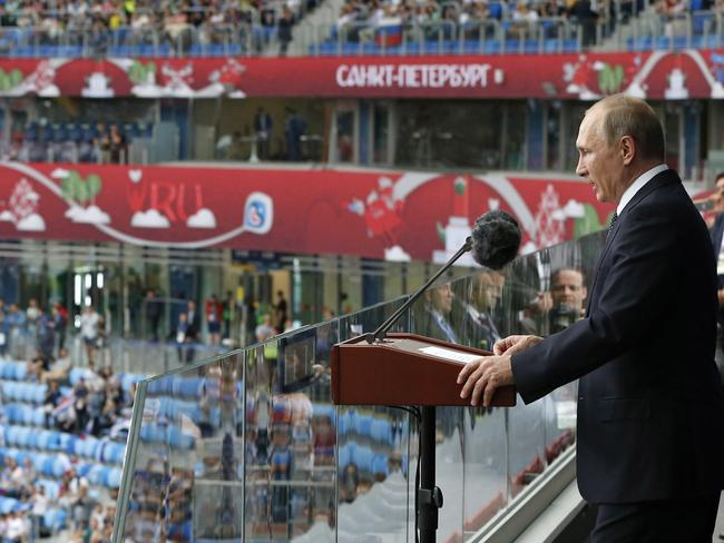 Russian President Vladimir Putin, right, speaks before the Confederations Cup.