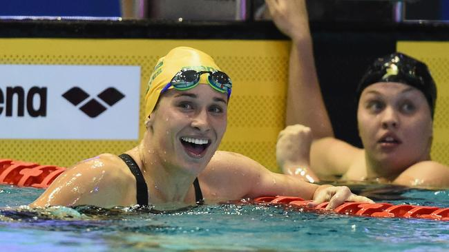 Madeline Groves (left) celebrates after winning the women's 4x200m freestyle relay. Picture: AAP