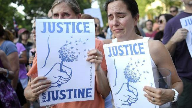 Community members took to the streets to march and demand Justice for Justine. Source: AP
