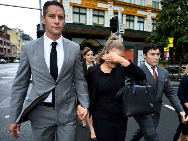 Sarah Jane Chisholm Rogers shields her face after her court appearance. Picture: AAP Image/Joel Carrett