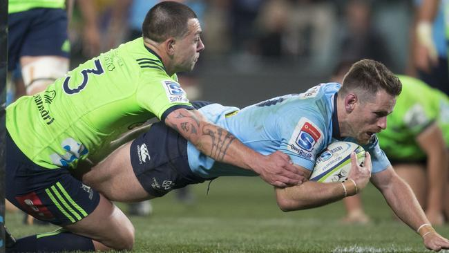 Bernard Foley of the Waratahs scores at Allianz Stadium in Sydney.