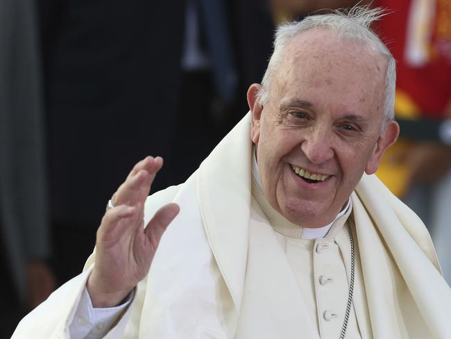 Pope Francis waves upon arrival to the international airport in Santiago, Chile. Picture: AP Photo/Esteban Felix