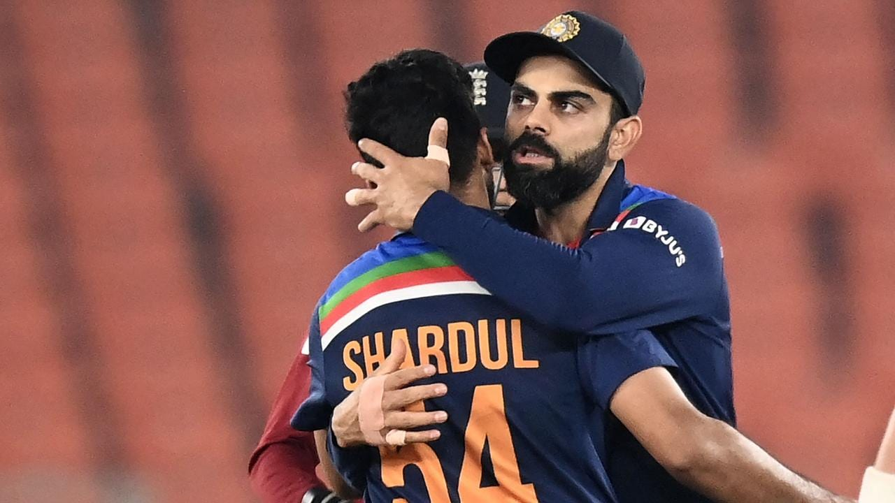 India's captain Virat Kohli (R) says his side is subjected to double standards. Photo: Getty Images