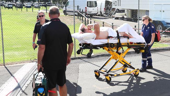 Tim Browne is wheeled to an ambulance with a spleen injury.