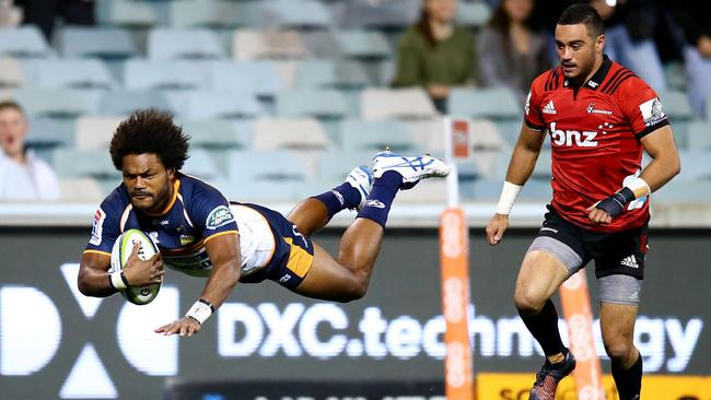 Henry Speight of the Brumbies dives to score a try at GIO Stadium.