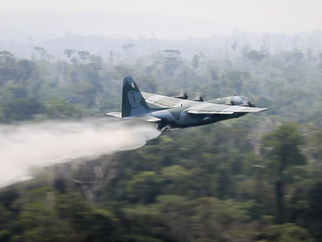 A C-130 Hercules aircraft dumps water to fight fires burning in the Amazon rainforest. Picture: Brazil Ministry of Defence