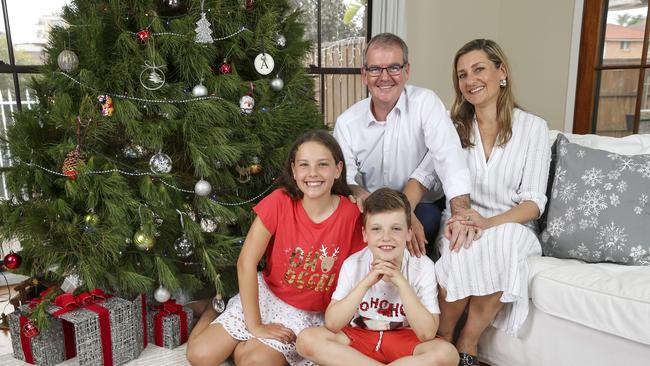 Michael Daley at home with his wife Christina and children Olivia, 12, and Austen, 8. Picture: Justin Lloyd