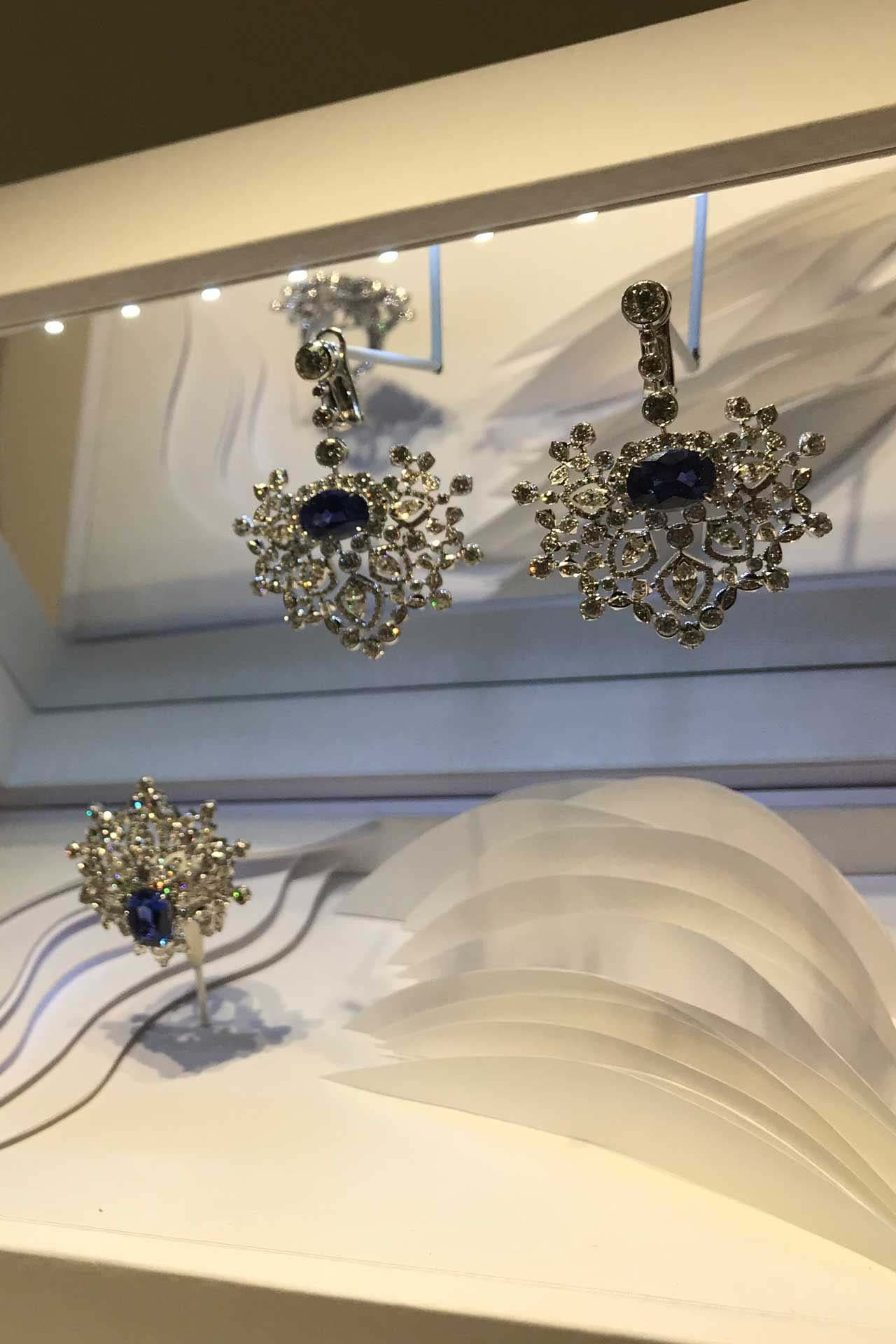Chaumet's diamond earrings and brooch set in white gold with sapphires from Ceylon. Image credit: Natasha Cowan