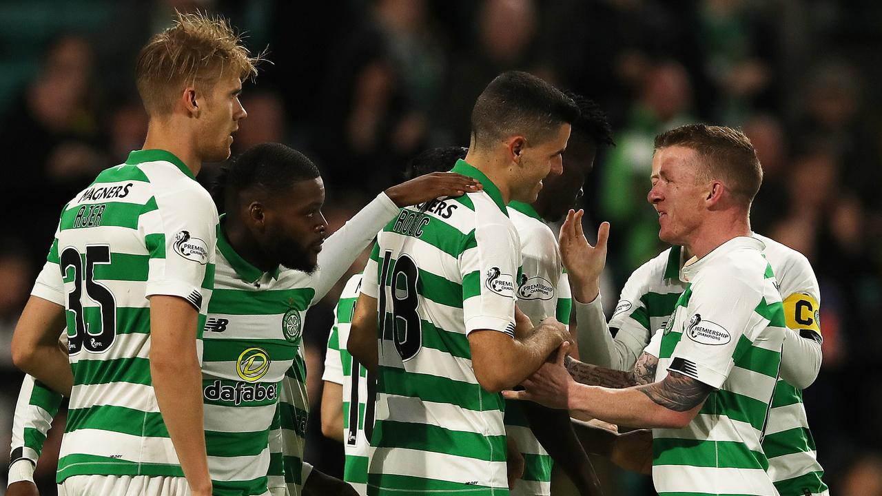 Tom Rogic (C) of Celtic mobbed by teammates after scoring on his first start of the season. (Photo by Ian MacNicol/Getty Images)
