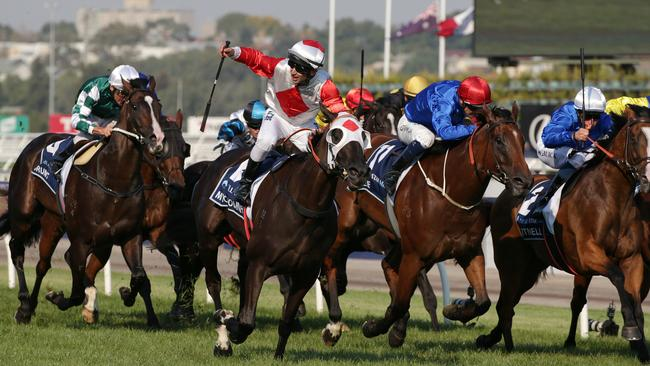 Mystic Journey (red and white) saluted in the inaugural All-Star Mile. Pic: AAP