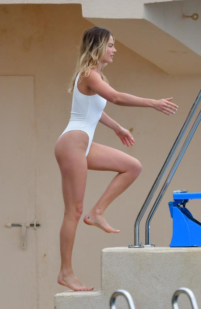 Margot Robbie was spotted heading up some steps, ready to dive into the sea water below. Picture: EliotPress / Mega