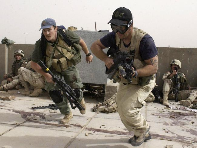 Civilian contractors from private security company Blackwater taking part in firefight in Najaf, Iraq, in 2004.