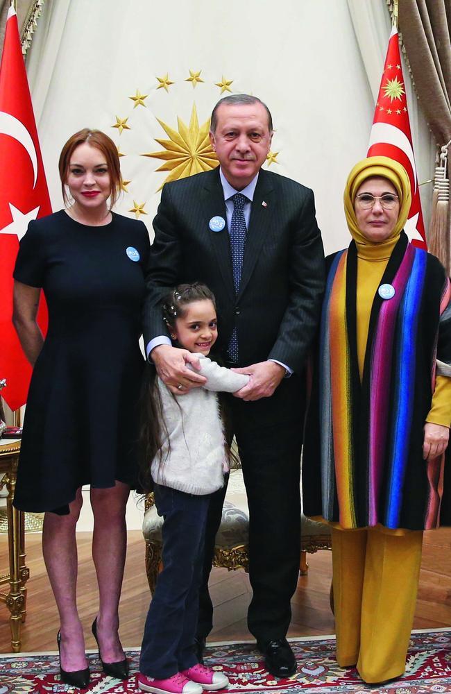 Lindsay Lohan poses next to Turkish President Recep Tayyip Erdogan, his wife Emine Erdogan and Bana el-Abed. Picture: Turkish Presidency/Yasin Bulbul/Anadolu Agency/Getty Images