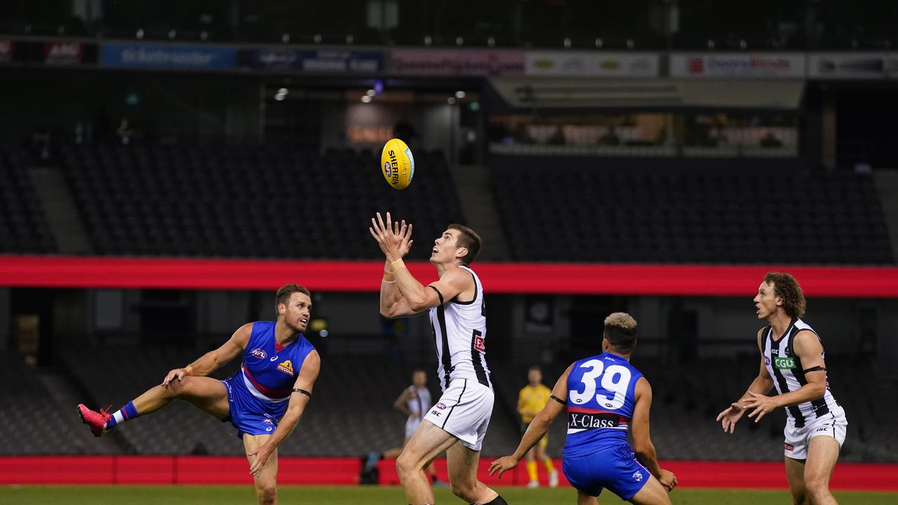 Mason Cox takes a mark against the Western Bulldogs in Round 1.