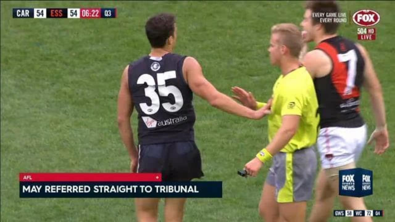 AFL screen shot of Ed Curnow touching an umpire.