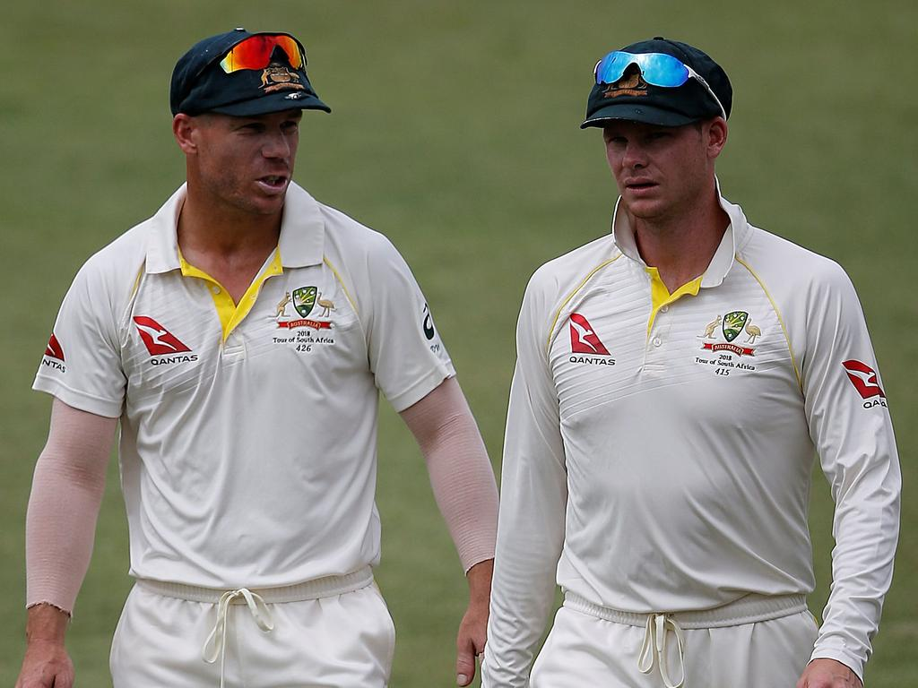 (FILES) This file photo taken on March 05, 2018 shows Australia cricketer David Warner and team captain Steven Smith leavin the field at the end of play in the fifth and final day of of the first Sunfoil cricket Test match between South Africa and Australia at the Kingsmead Stadium in Durban Cricket Australia confirmed one year bans for Steve Smith and David Warner on March 28, 2018, following revelations concerning ball-tampering. / AFP PHOTO / MARCO LONGARI