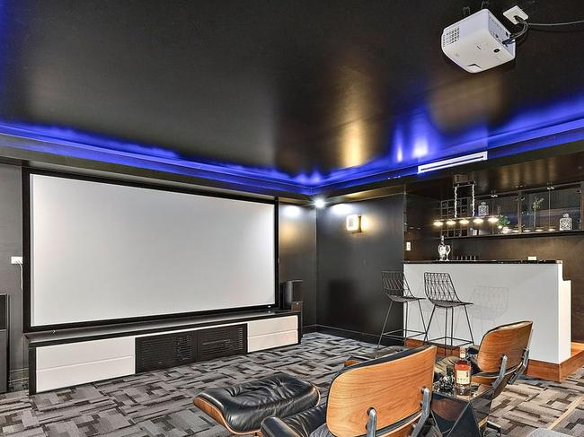 The cinema room with wet bar.