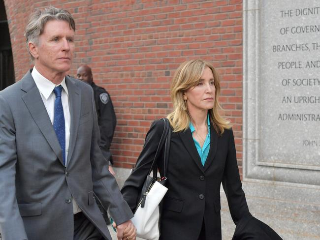 Felicity Huffman exits the court with her brother. Picture: Paul Marotta/Getty Images